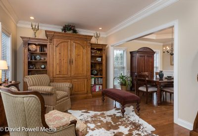 Living room with connecting formal dining room and hardwood floors