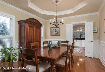 Formal dining room with trey ceiling and hardwood floors.