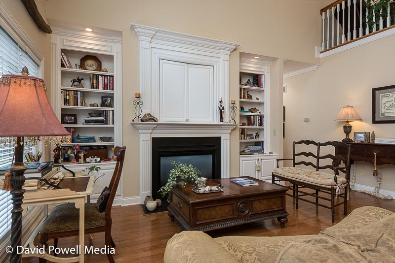 Open family room with fireplace and built in book cases