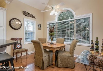 Breakfast area features large windows and hardwood floors